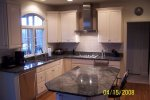 Kitchen upgraded with granite tops, tile backsplash, new appliances.
